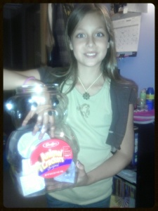 Look how cute she is!!!  And yes...that is a very large and empty animal cracker container..YUMMY!)